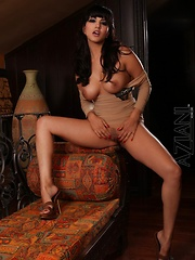 Gorgeous busty brunette, Sunny Leone, is sporting a beautiful dress and heels.  She strips down revealing her amazing body and beautiful big boobs for all to see! - Erotic and nude pussy pics at GirlSoftcore.com