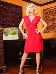 Nicole Aniston looks sultry in her slinky red dress and black high heels.  Even better, she shows you all the goodness underneath!