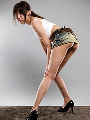 Oshima Karina posing in mini skirt - Erotic and nude pussy pics at GirlSoftcore.com