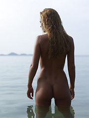 On a sunny day, Thea is relaxing by the beach, totally naked!  - Erotic and nude pussy pics at GirlSoftcore.com