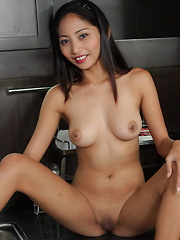 Flashing my big boobies and my bald slit in the kitchen - Erotic and nude pussy pics at GirlSoftcore.com