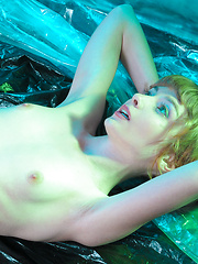 Gorgeous sweetheart like to be photographed in unusual places. For today the studio will be replaced with tent made of foil. - Erotic and nude pussy pics at GirlSoftcore.com