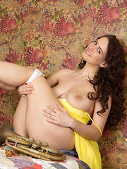 Sweet as well desirable music loving girl pose in frantic yellow summer outfit. Extra busty natural boobs as well sweet smile. - Erotic and nude pussy pics at GirlSoftcore.com