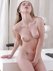Stunning nubile Kortny gets horny in the office - Erotic and nude pussy pics at GirlSoftcore.com