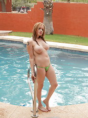 Hot mommy strips her thong bikini and masturbates in an outdoor shower - Erotic and nude pussy pics at GirlSoftcore.com