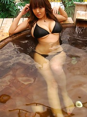 Hitomi Tanaka in one of her first photo shooting! Sexy huge boobs in black bikini! - Erotic and nude pussy pics at GirlSoftcore.com