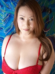 Busty Asian babe posing in red lingerie - Erotic and nude pussy pics at GirlSoftcore.com