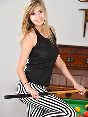 Holly Anderson fingers her pink pussy over the billiards table