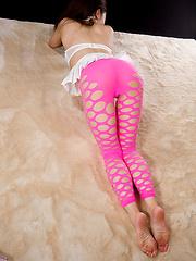 Maeshiro Shizuka posing in pink pantyhose - Erotic and nude pussy pics at GirlSoftcore.com