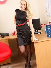 A sexy tight black dress and stockings makes Lucy Anne the perfect secretary in any office - Erotic and nude pussy pics at GirlSoftcore.com
