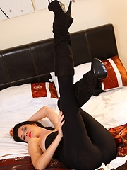 Natalie slips out of the sexy black leggings and revealing top to show off her beautiful long legs - Erotic and nude pussy pics at GirlSoftcore.com