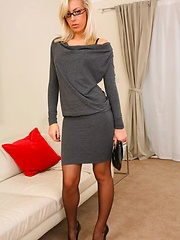 Beauty secretary looks stunning in minidress and stockings. - Erotic and nude pussy pics at GirlSoftcore.com