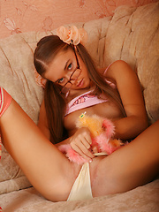 Yummy girl wearing pigtails and glasses playfully strips revealing her nice tits and pussy. - Erotic and nude pussy pics at GirlSoftcore.com