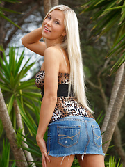 Dido A the tempting Tigress dressed in a sexy leopard top and denim mini skirt. She is the queen of the jungle. - Erotic and nude pussy pics at GirlSoftcore.com