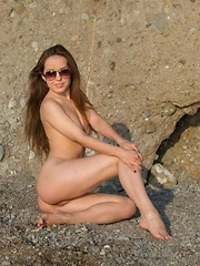 Arina G flaunts her perfect body on the beach in her sexy white swimsuit - Erotic and nude pussy pics at GirlSoftcore.com