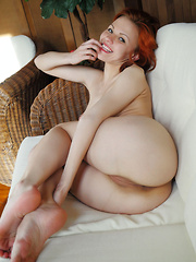 Zarina A a sexy redheaded siren with exquisite pink pussy lips