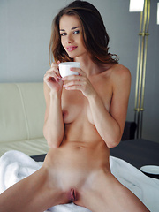 Loretta A feelin naughty and seductive before taking a shower - Erotic and nude pussy pics at GirlSoftcore.com