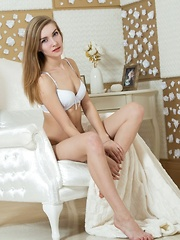 Wearing a matching white lingerie, Maryana can't wait to take sexy garments to showcase her firm ass and shaved pussy - Erotic and nude pussy pics at GirlSoftcore.com