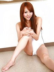 Saki Ueda Asian in gym suit spreads legs while playing on floor - Erotic and nude pussy pics at GirlSoftcore.com