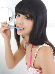Sakura Sato Asian is sexy even when brushing her hair and teeth - Erotic and nude pussy pics at GirlSoftcore.com