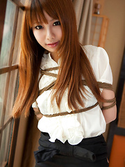 Dimdim Asian in tight office skirt and blouse is tied in ropes - Erotic and nude pussy pics at GirlSoftcore.com