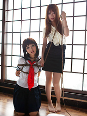 Dimdim Asian in uniform is tied in ropes by another sexy cupcake - Erotic and nude pussy pics at GirlSoftcore.com