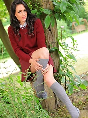 Dark haired college girl loves the outdoors and the passers by love the view of her slipping out of her uniform - Erotic and nude pussy pics at GirlSoftcore.com