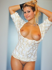 Sierra strips with busty tits and pierced pussy - Erotic and nude pussy pics at GirlSoftcore.com