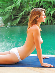 Karina gets naked by the pool takes a dip and dries off - Erotic and nude pussy pics at GirlSoftcore.com