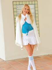 Nikkie in a school girl outfit pulls her labia hard - Erotic and nude pussy pics at GirlSoftcore.com
