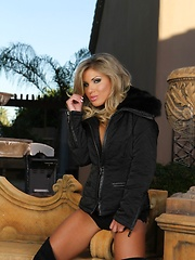 Sexy busty blonde babe, Aubrey Addams, struts her stuff outdoors looking so yummy delicious in nothing but her black jacket, black panties and big black boots. - Erotic and nude pussy pics at GirlSoftcore.com