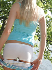 Cute teen Skye is by the lake as she shows off her perfect ass and teases with perky tits - Erotic and nude pussy pics at GirlSoftcore.com