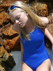 Blonde teen Skye shows off her tight little body at the pool in a tight one piece bathing suit - Erotic and nude pussy pics at GirlSoftcore.com