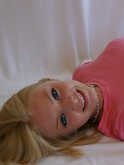 Super cute Skye poses for pictures in a tight pink shirt and grey sweat capris - Erotic and nude pussy pics at GirlSoftcore.com