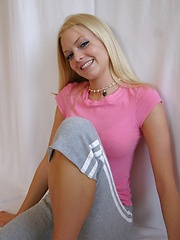 Super cute Skye poses for pictures in a tight pink shirt and grey sweat capris