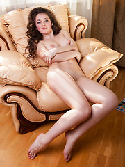 Conchita relaxes on the couch, naked and uninhinbited - Erotic and nude pussy pics at GirlSoftcore.com
