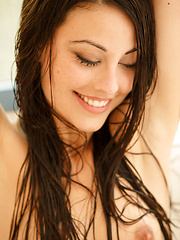 Playful, fun, and charming Lorena B is a delight to watch while taking a shower - Erotic and nude pussy pics at GirlSoftcore.com