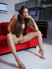 Tristina A poses confidently, flaunting her enviable slender physique.