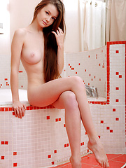 Emily Bloom plays naked in the bath tub - Erotic and nude pussy pics at GirlSoftcore.com
