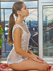 Adorable Nastya K posing in white knitted top - Erotic and nude pussy pics at GirlSoftcore.com