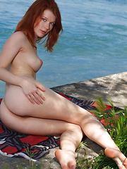 Mia Sollis plays naked by the river - Erotic and nude pussy pics at GirlSoftcore.com