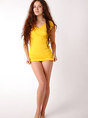 Norma A in bright yellow bodycon dress - Erotic and nude pussy pics at GirlSoftcore.com