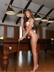 Ryanel A poses and stretches on top of the pool table - Erotic and nude pussy pics at GirlSoftcore.com