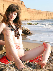 Lusi A plays naked in the sand - Erotic and nude pussy pics at GirlSoftcore.com