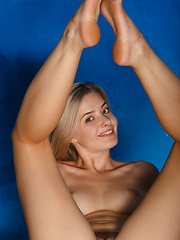 Edwige A raises the room\'s temperature as she flirts with the camera - Erotic and nude pussy pics at GirlSoftcore.com