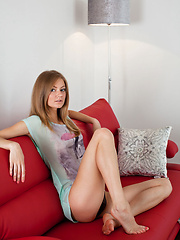 Sexy blonde Patritcy A relaxes on the sofa - Erotic and nude pussy pics at GirlSoftcore.com