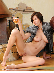 Suzanna shows off her magnificent breasts, slim waist, shavd pussy, and long legs by the fireplace - Erotic and nude pussy pics at GirlSoftcore.com
