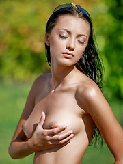 beautiful Anna AJ tans naked in the sun