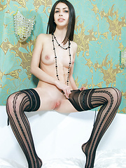 Flora C\'s long and slender physique accentuated by her black thigh-high fishnet stockings - Erotic and nude pussy pics at GirlSoftcore.com