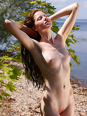 Captivating girl on seashore - Erotic and nude pussy pics at GirlSoftcore.com
